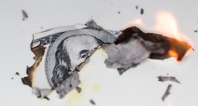 Burning Money Kraked.jpeg